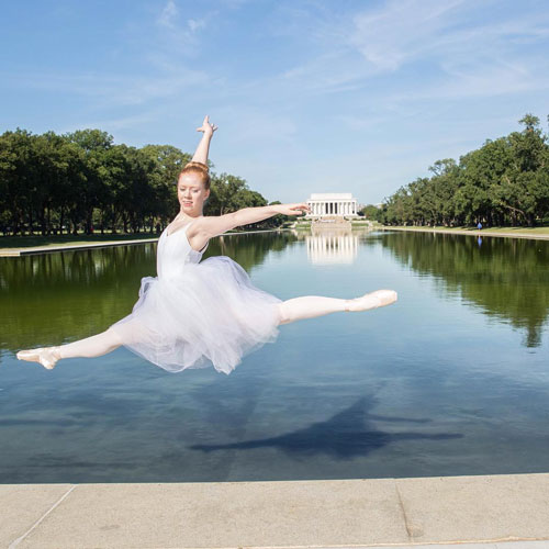 A GW ballet dancer jumps in front of the Lincoln Memorial